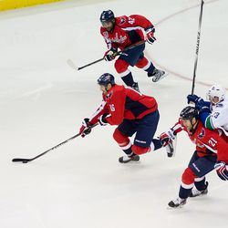 Fehr Carries Puck Flanked By Ward and Laich