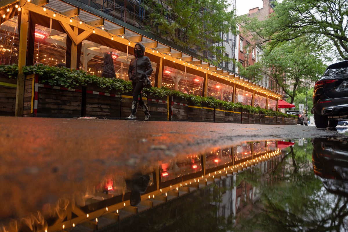A person walks past Via Carota's outdoor dining on Memorial Day weekend on May 29, 2021 in New York City.