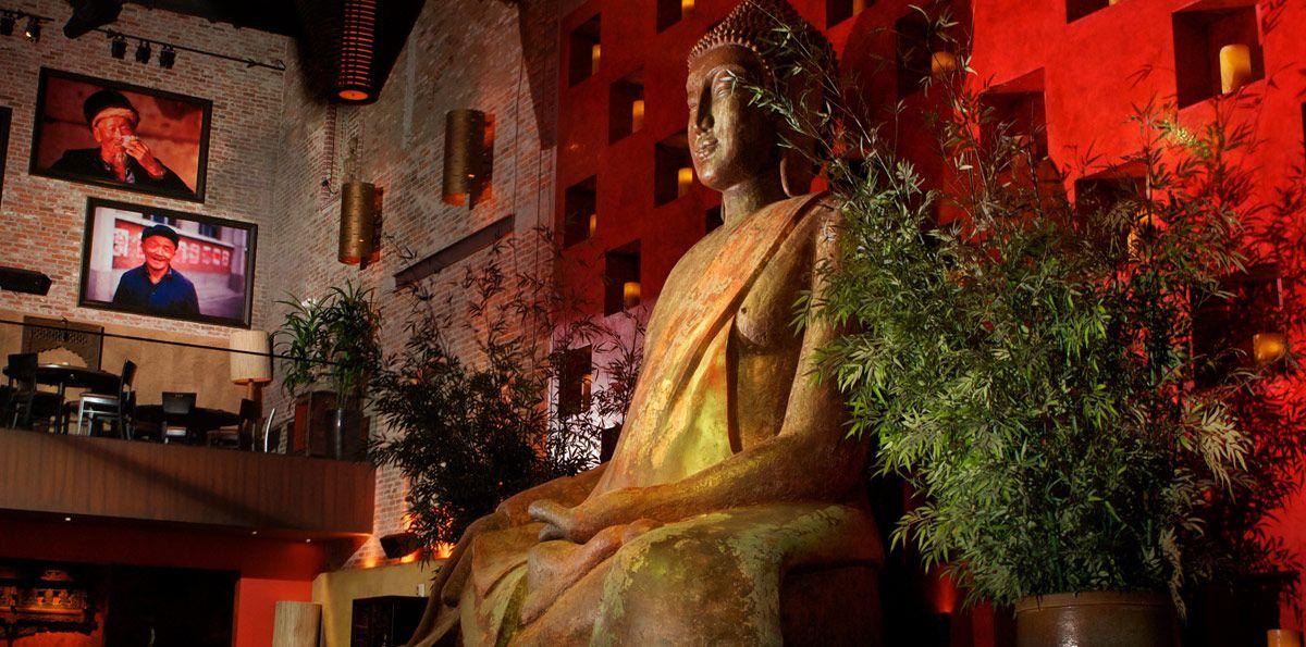 A side angle view of a giant Buddha