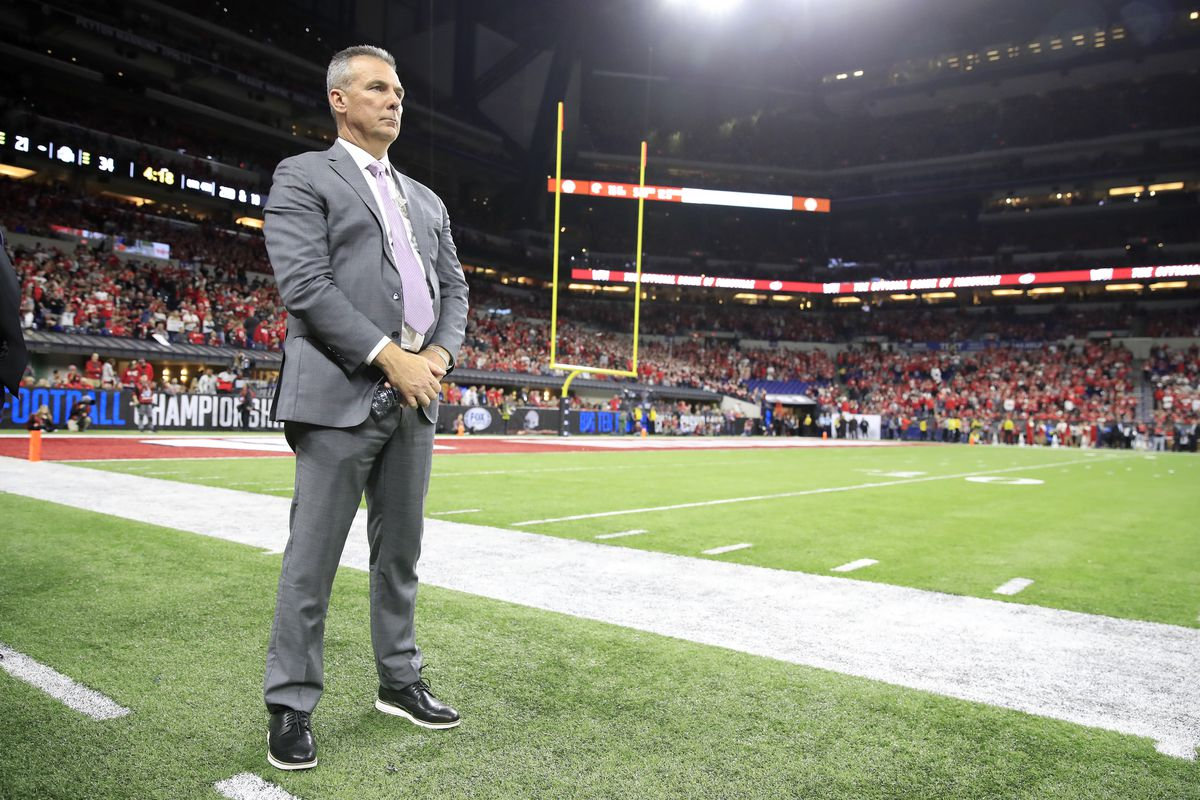 Urban Meyer watches the action during the BIG Ten Football Championship at Lucas Oil Stadium on December 07, 2019 in Indianapolis, Indiana.