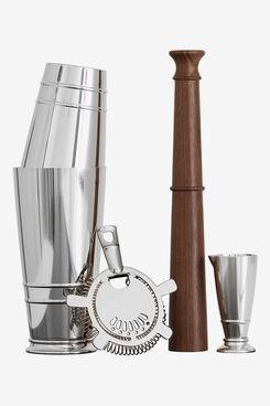 A shaker, muddler, strainer, and jigger set