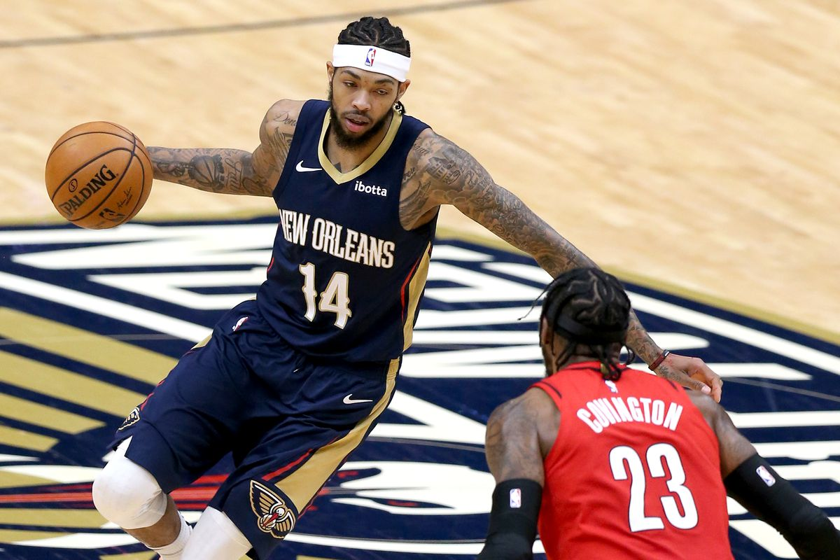 Brandon Ingram #14 of the New Orleans Pelicans dribbles the ball down court during the fourth quarter of an NBA game against the Portland Trail Blazers at Smoothie King Center on February 17, 2021 in New Orleans, Louisiana.