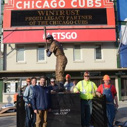 5:47 p.m. Work crew posing with the statue -