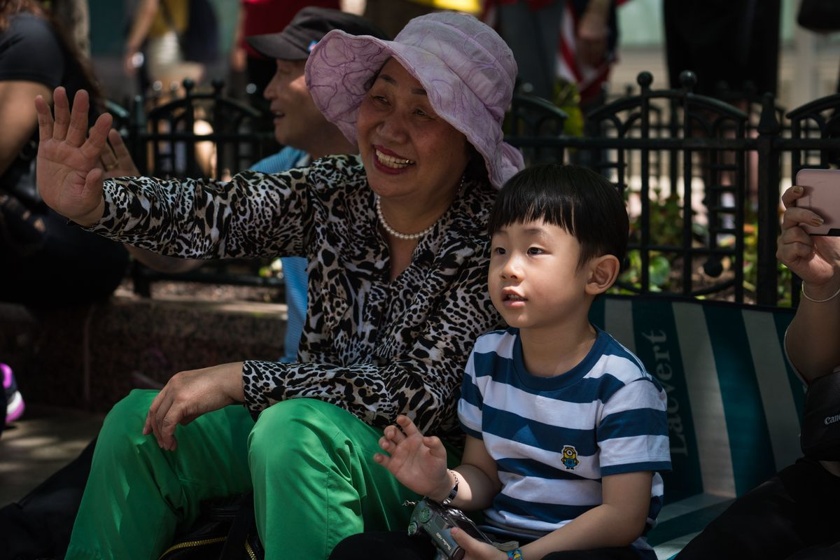 Danny Cho and his grandmother, Sue Noh, watch the Chicago Memorial Day Parade in 2018.