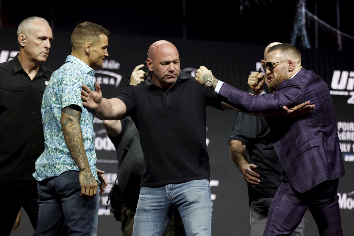 Conor McGregor, right, and Dustin Poirier are kept apart by UFC President Dana White during a press conference ahead of UFC 264 at the T-Mobile Arena in Las Vegas, Nevada, USA.