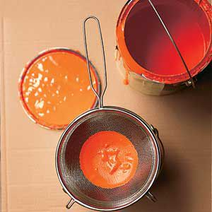 <p>Strain old paint to rid it of debris.</p>