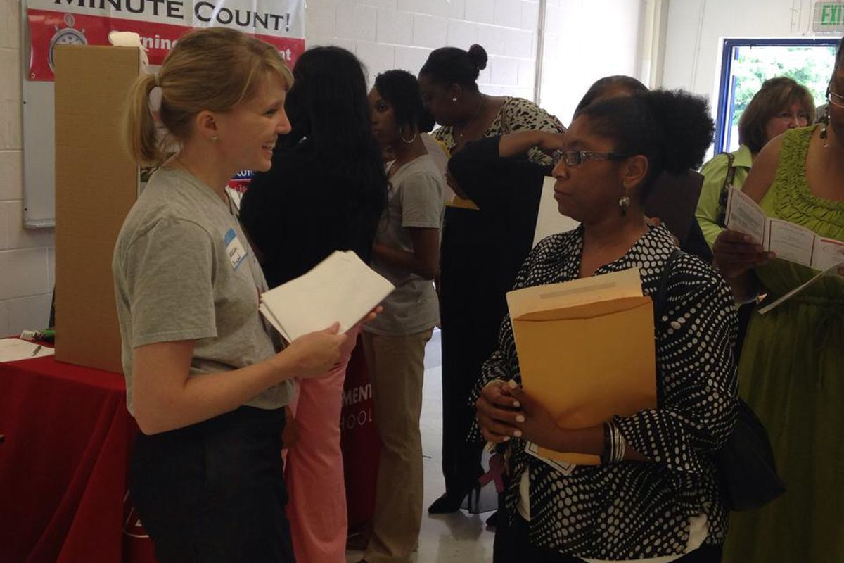 Teachers and employers network at a 2014 hiring fair in the Frayser community of Memphis. Shelby County Schools is hosting a jobs fair in June to assist displaced teachers.