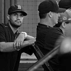 Justin Su'a is photographed in the Greenville Drive dugout.