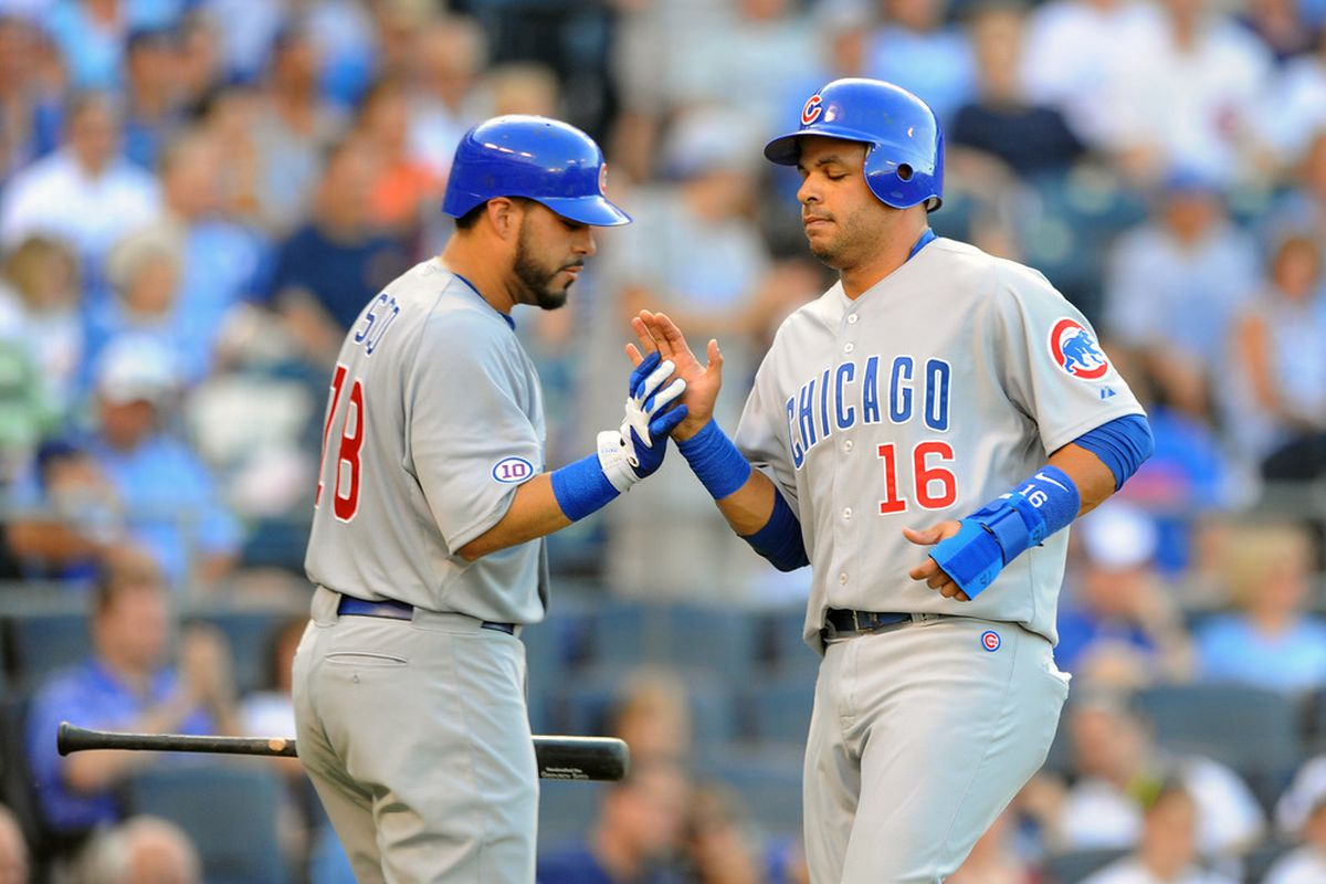Aramis Ramirez of the Chicago Cubs is greeted by Geovany Soto after scoring a run in the first inning against the Kansas City Royals at Kauffman Stadium on June 24, 2011 in Kansas City, Missouri. (Photo by G. Newman Lowrance/Getty Images)