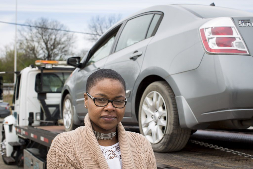 Symone Smith with her newly reclaimed 2010 Nissan Sentra, which had been impounded for the last five years. | Michelle Kanaar / Sun-Times