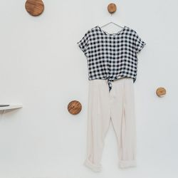 """Gingham Tied Crop Top, <a href=""""http://7115newyork.com/collections/apparel/products/gingham-tied-cropped-top-black"""">$78</a>; Gathered Trousers, $138"""