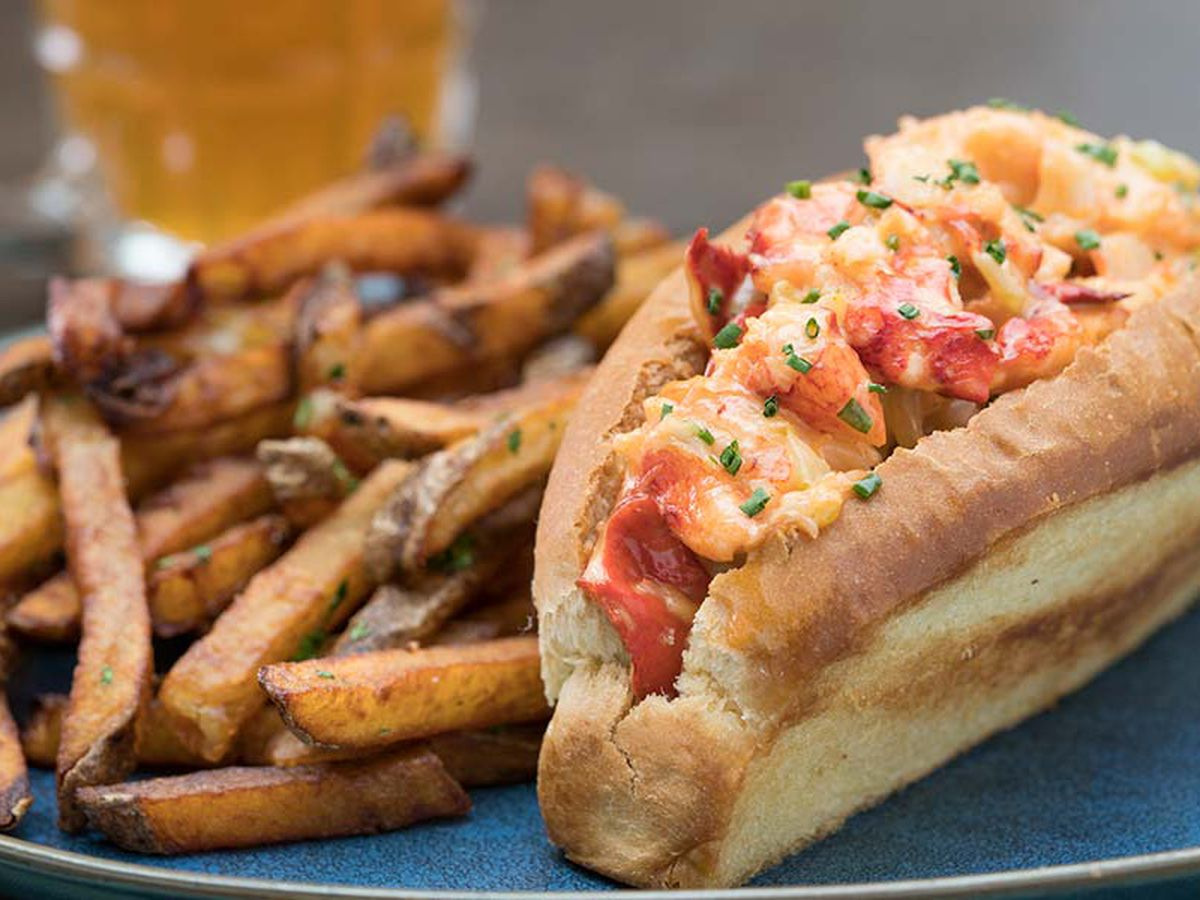 A plate of lobster roll and fries.