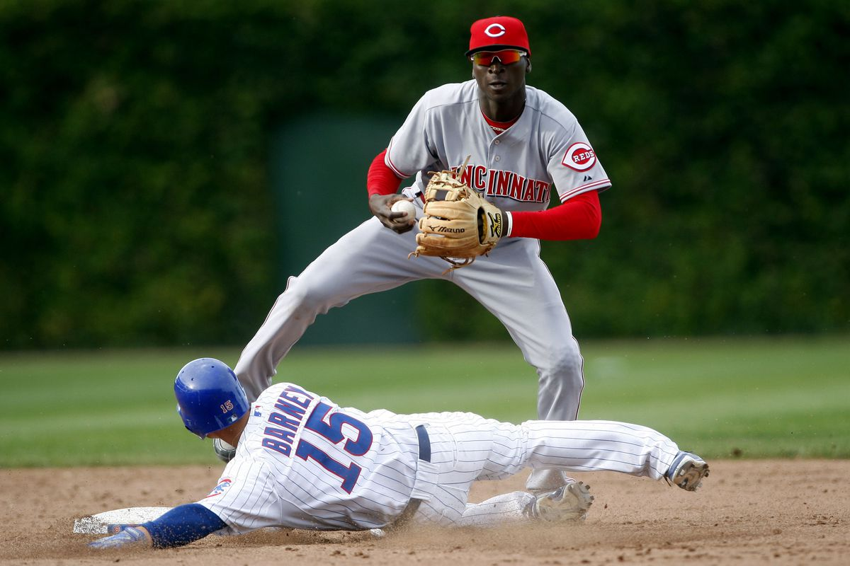 Sep 20, 2012; Chicago, IL, USA; Chicago Cubs second baseman Darwin Barney (15) is forced out by Cincinnati Reds shortstop Didi Gregorius during the ninth inning at Wrigley Field.  The Reds won 5-3. Mandatory Credit: Jerry Lai-US PRESSWIRE