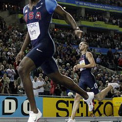 LaShawn Merritt of the United States crosses the finish line to win gold in the Men's 400m ahead of his compatriot Jeremy Wariner, right, who took the silver during the World Athletics Championships in Berlin on Friday.