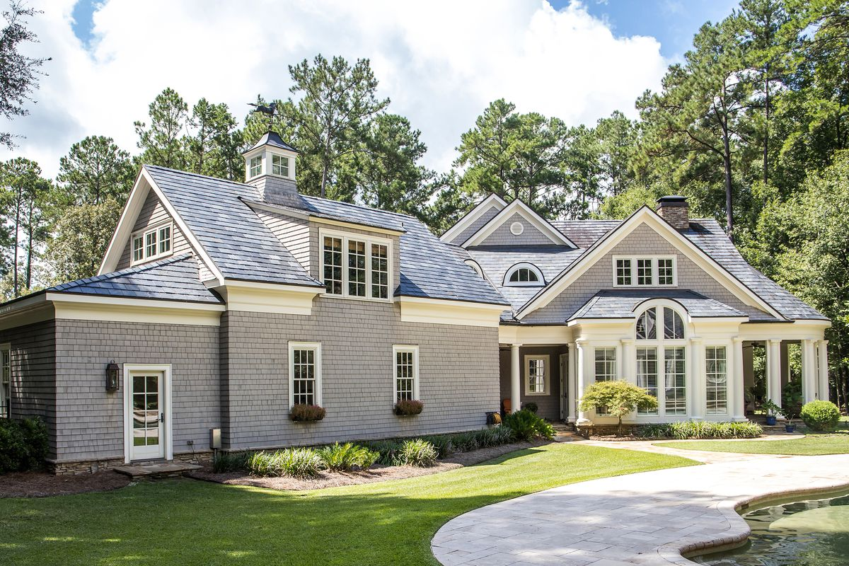 Front view of large cape cod style home.