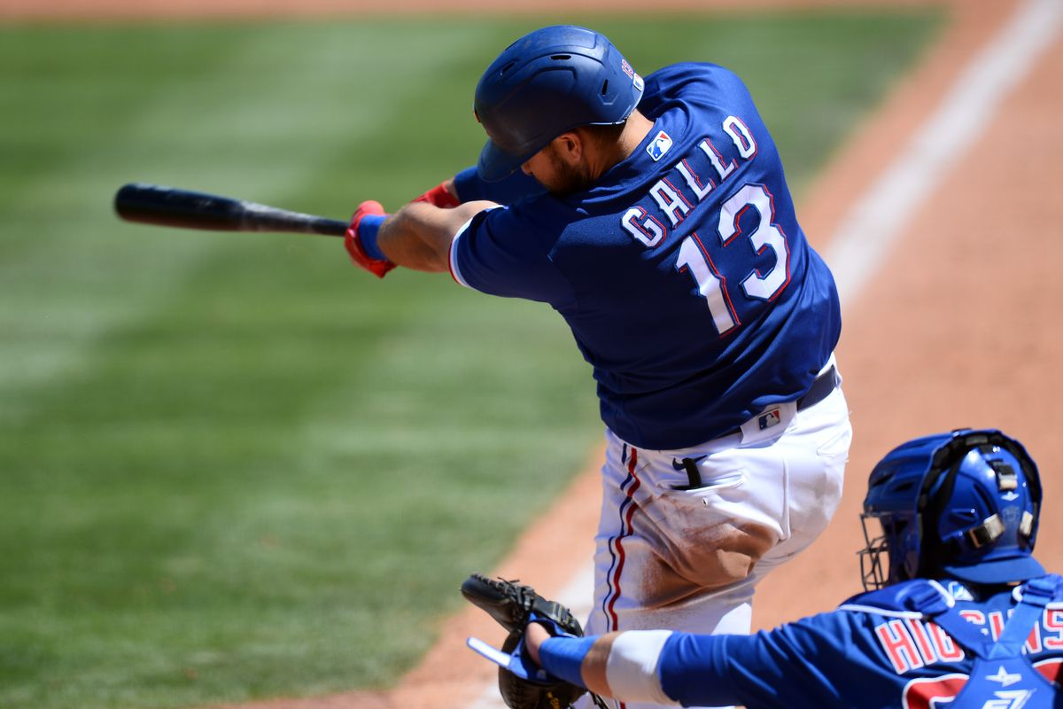 Texas Rangers right fielder Joey Gallo hits a home run against the Chicago Cubs during the second inning of a spring training game at Surprise Stadium.