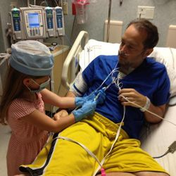 Rich and Amy Goade's youngest daughter, Rosie, visits her dad in the hospital last year.