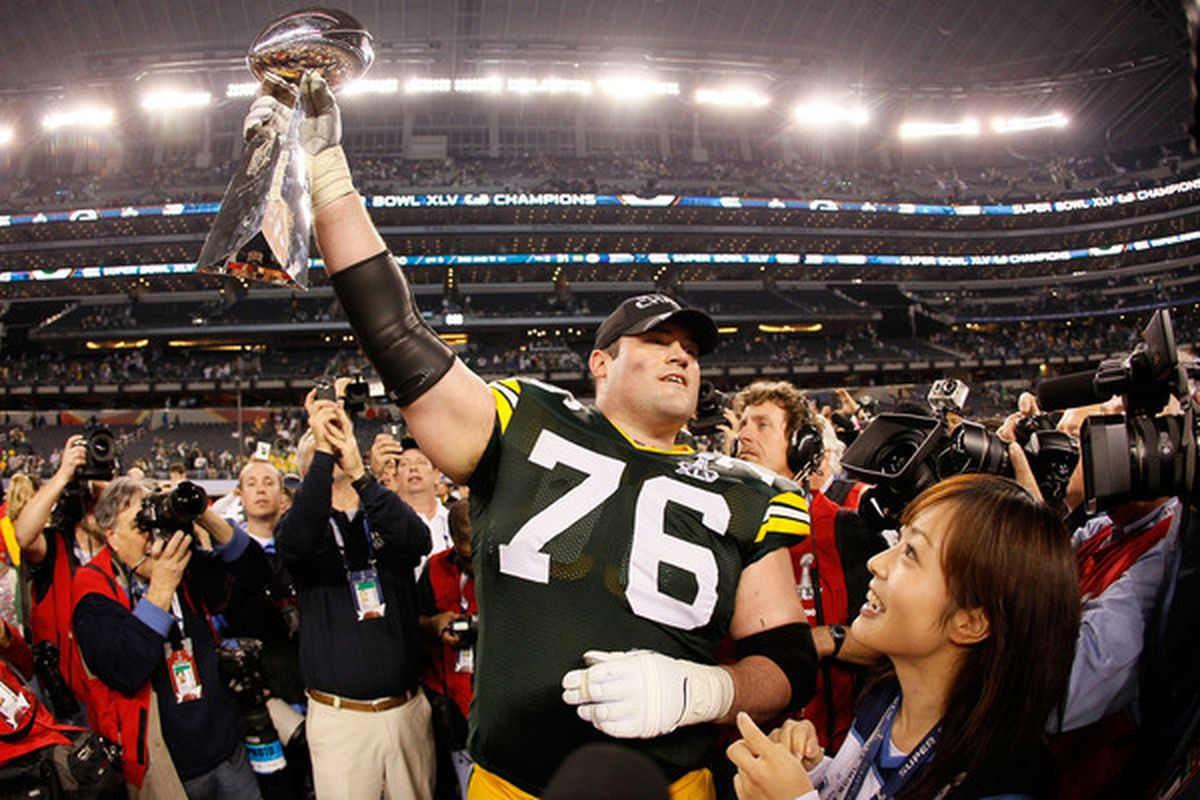 ARLINGTON TX - FEBRUARY 06: Chad Clifton #76 of the Green Bay Packers holds up the Vince Lombardi Trophy after winning Super Bowl XLV 31-25 against the at Cowboys Stadium on February 6 2011 in Arlington Texas.  (Photo by Kevin C. Cox/Getty Images)