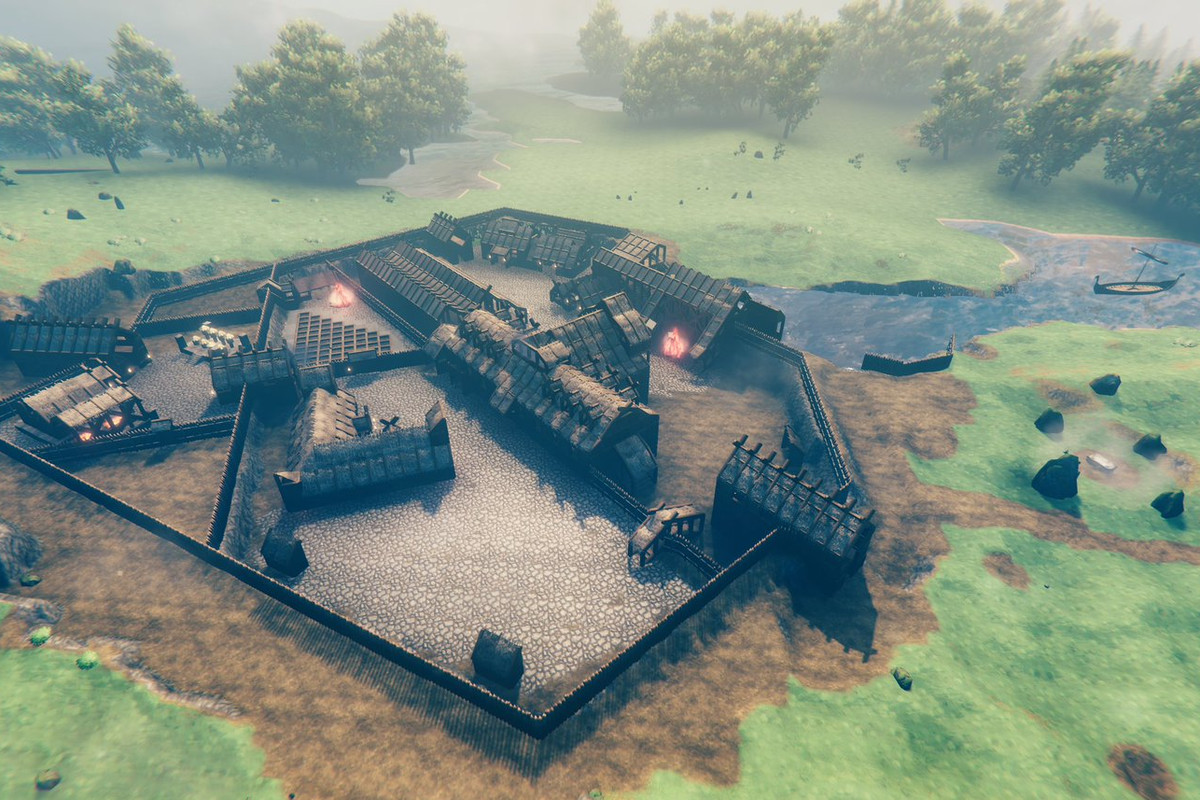 Valheim - an aerial shot of a meticulously plotted and built Viking village