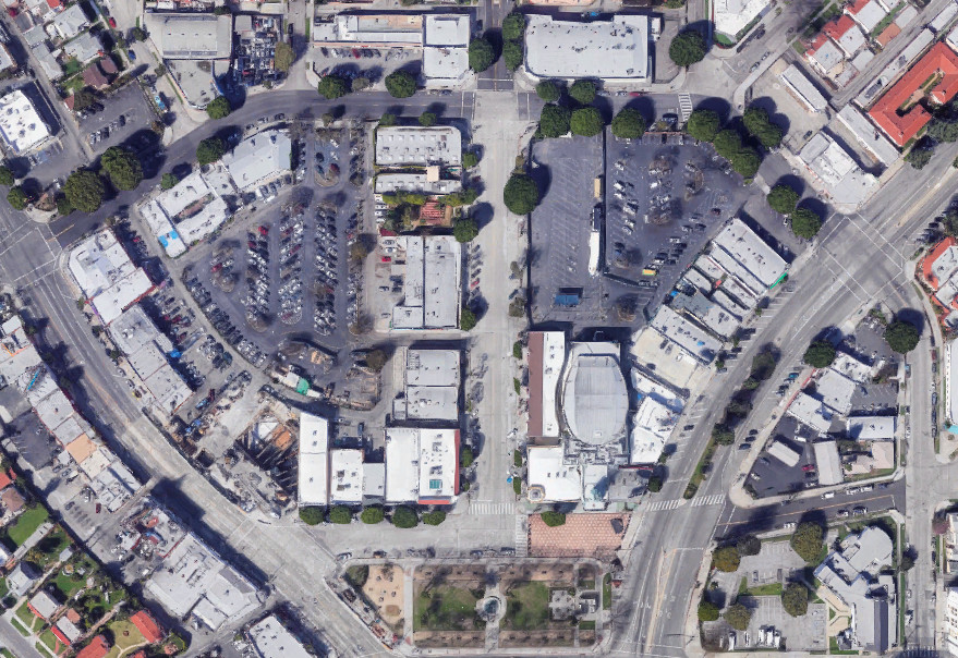 An aerial photo showing Leimert Park Village, a largely commercial area of lower-rise buildings bisected by major streets.