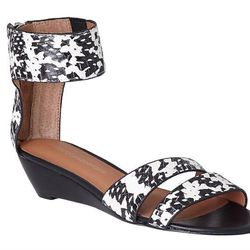 """<b>Rebecca Minkoff</b> Open Toe Snakeskin Sandals, <a href=""""http://www1.bloomingdales.com/shop/product/rebecca-minkoff-open-toe-snakeskin-sandals-lore-demiwedge?ID=975280"""">$195</a> at Bloomingdale's"""