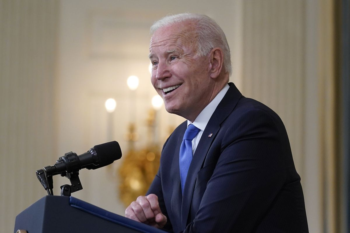 In this May 5, 2021, file photo President Joe Biden takes questions from reporters as he speaks about the American Rescue Plan, in the State Dining Room of the White House in Washington.