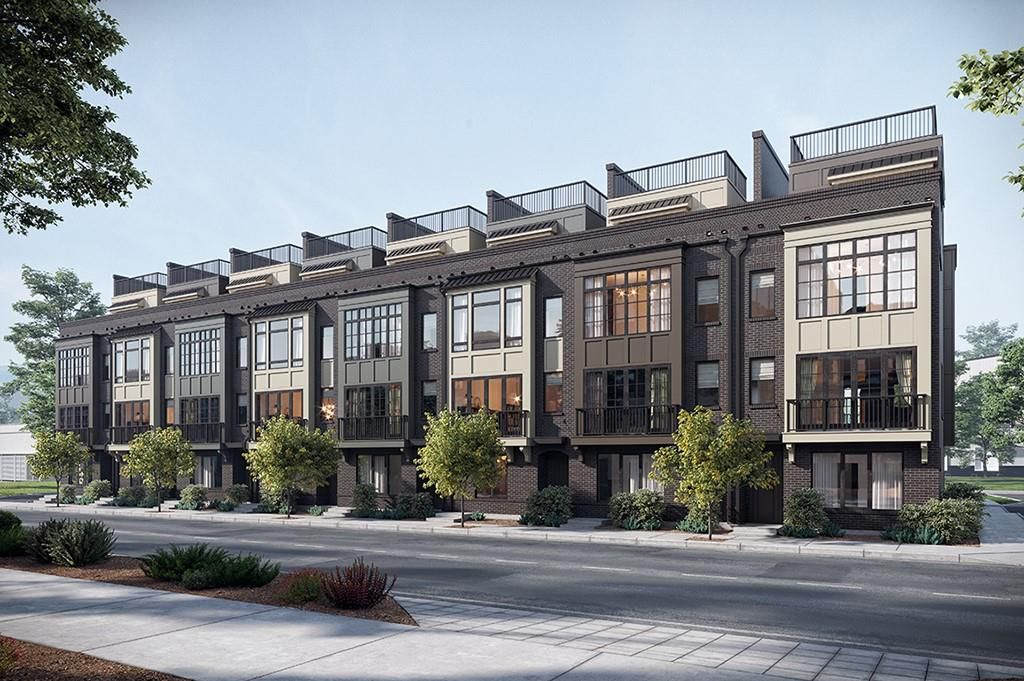 The facade of a townhome row in Atlanta with roof decks.