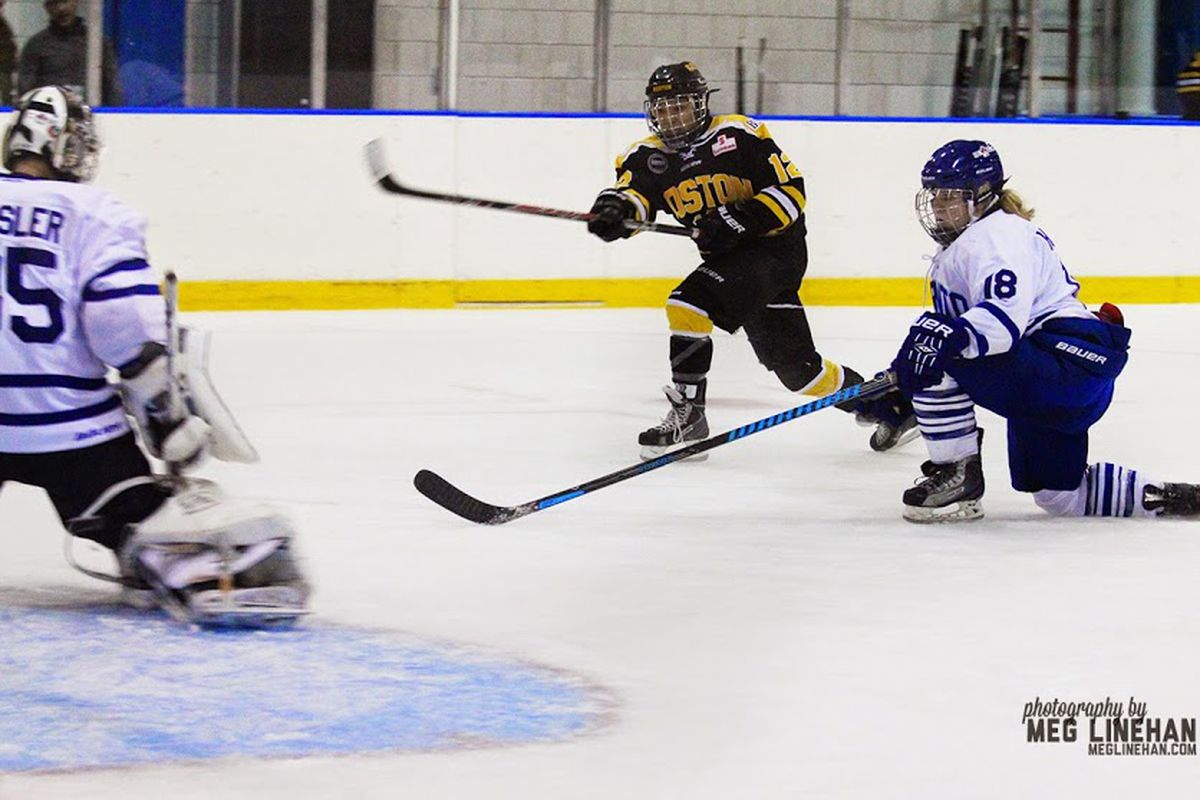 Rachel Llanes shoots and scores on the Toronto Furies' Christina Kessler in a Boston Blades home game at the Clark Athletic Center, UMass Boston on 11/15/14