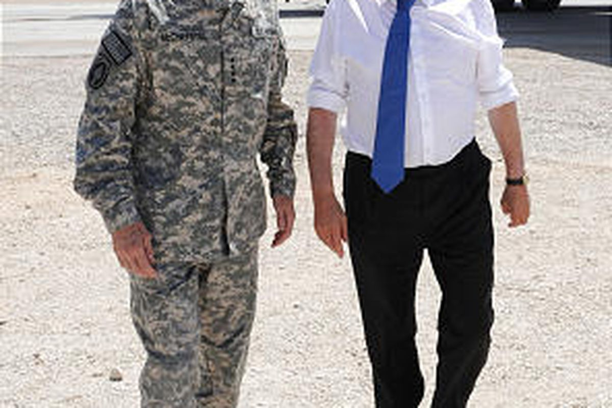 Britain's Prime Minister Gordon Brown, right, is greeted by Gen. Stanley McChrystal, left, the head of U.S. and NATO forces in Afghanistan, at Camp Bastion in Lashkar Gah in Afghanistan, Saturday.