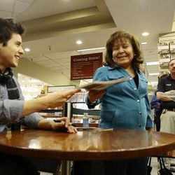 David Archuleta signs autographs at a signing event at the Deseret Book at Ft. Union in Midvale on Nov. 22.