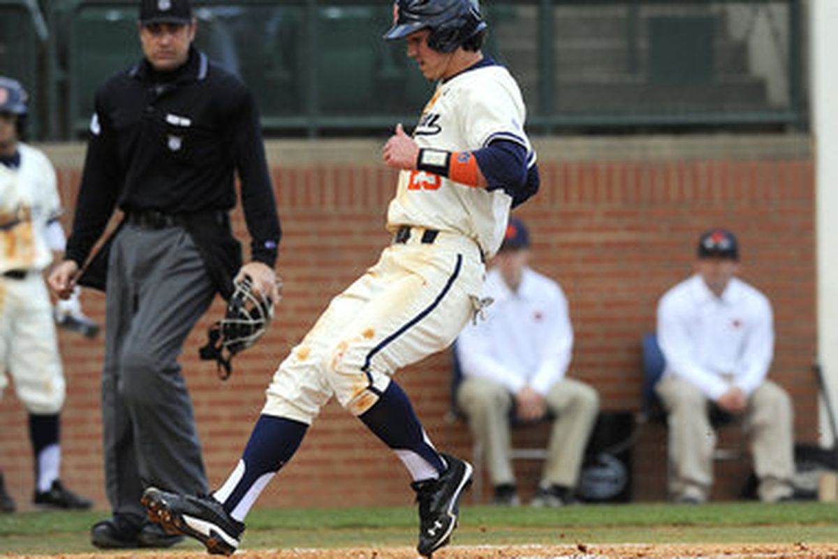 Dan Glevenyak's 10th inning sacrifice fly gave Auburn the series victory over LSU Saturday night in Auburn. Glevenyak is pictured above crossing the plate earlier this year in Samford Stadium.<em> (photo by Todd Van Ernst)</em>
