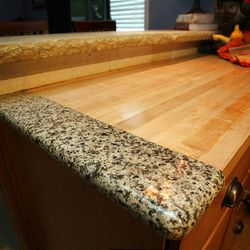 Mary Fox's kitchen is an example of reuse which is actually more eco friendly than recycled countertops.