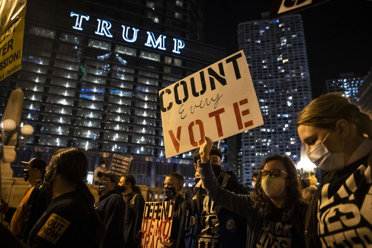 Hundreds march through the Loop to demand every vote be counted in the general election, Wednesday night, Nov. 4, 2020. A full day after Election Day, neither candidate had cleared the 270 Electoral College votes needed to win the White House as President Donald Trump's campaign has filed lawsuits and attempted to stop ballot counting in Michigan, Georgia and Pennsylvania.