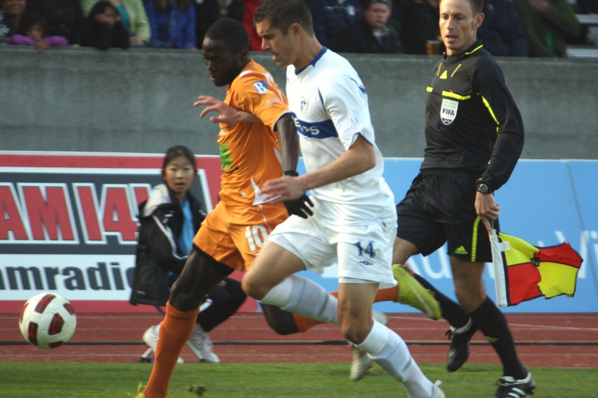 Greg Janicki of the Vancouver Whitecaps in competition with Kendall Jagdeosingh of the Puerto Rico Islanders. (Benjamin Massey/Eighty Six Forever)