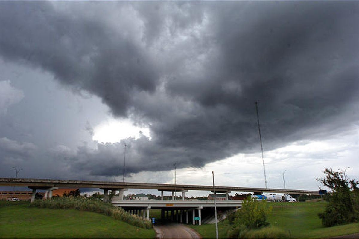 The storm system that spawned a tornado that touched down in a commercial district of Beaumont, Texas, moves east after causing damage to many businesses and sending up to 10 people to area hospitals.