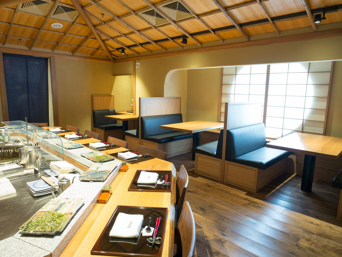 Tempura Matsui's dining room has booths in the back and a bar up front