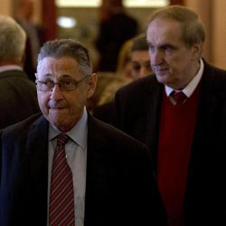 FILE- In this April 18, 2012, file photo, Assembly Speaker Sheldon Silver, D-Manhattan, left, walks with Assemblyman Vito Lopez, D-Brooklyn, to an affordable housing news conference at the Capitol in Albany, N.Y. Accusations of sexual harassment that emerged over the summer have unraveled in public before a state ethics committee, revealing more sexual misconduct accusations against Lopez and a secret six-figure payoff to the accusers with taxpayer money that was approved by Silver.