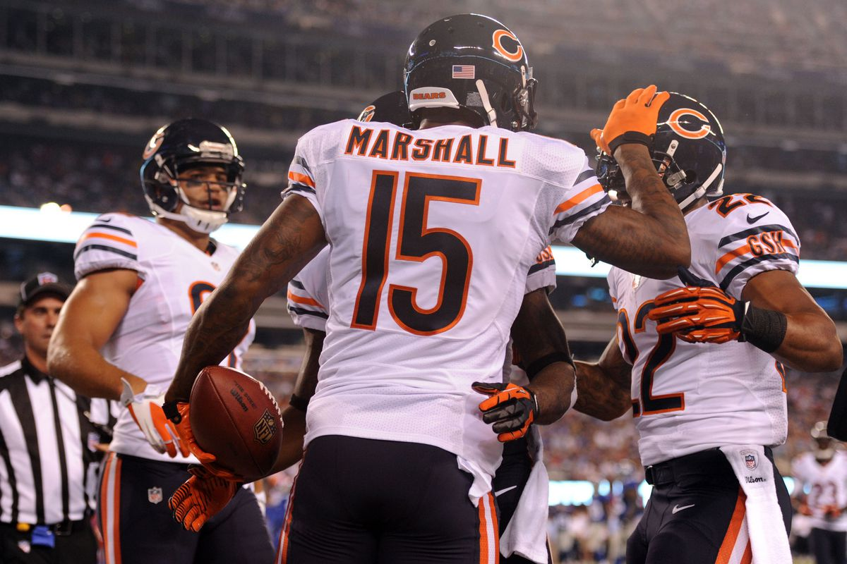 Aug 24, 2012; East Rutherford, NJ, USA;  Chicago Bears wide receiver Brandon Marshall (15) celebrates a touchdown catch during the first half against the New York Giants at Metlife Stadium. Mandatory Credit: Joe Camporeale-US PRESSWIRE