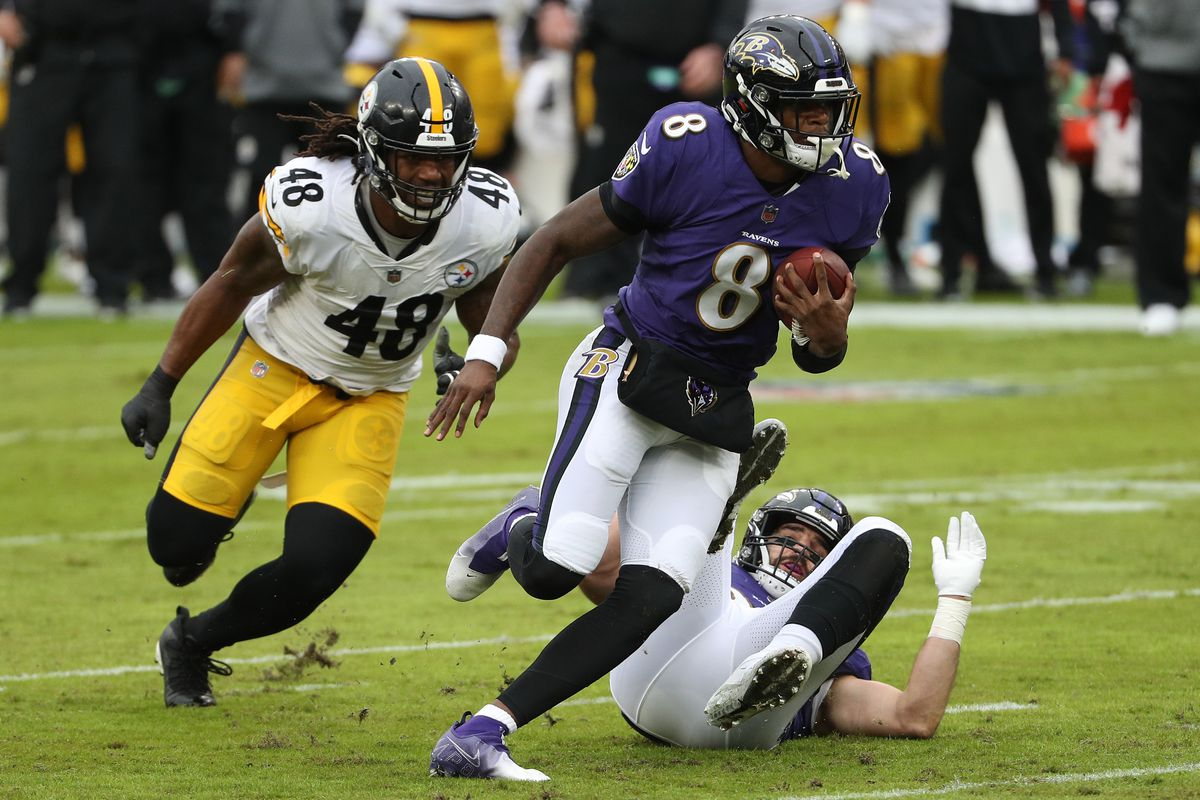 Quarterback Lamar Jackson #8 of the Baltimore Ravens rushes with the ball against the Pittsburgh Steelers at M&T Bank Stadium on November 01, 2020 in Baltimore, Maryland.