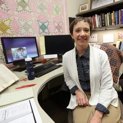 Jenny Reeder, women's history specialist, poses for a photo in her office at the LDS Church History Library in Salt Lake City on Thursday, Dec. 3, 2015.