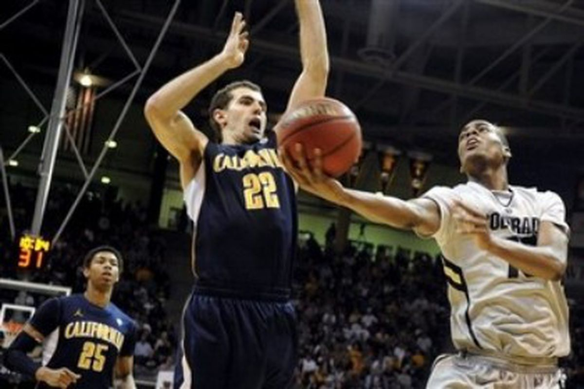 Colorado's Alec Burks (right) lays in two of his game high 25 points against California's Harper Kamp in the Buffalo's 89-72 win over the Golden Bears Friday night in the NIT.  (AP Photo)