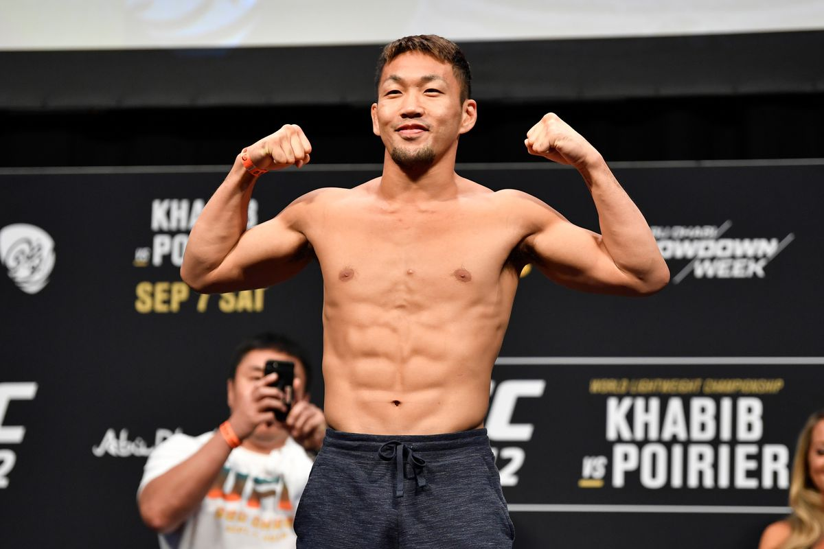 Takashi Sato of Japan poses on the scale during the UFC 242 weigh-in at The Arena on September 6, 2019 in Abu Dhabi, United Arab Emirates.