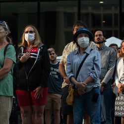 People watch the commemoration of the 20th anniversary of 9/11 at the Richard J. Daley Plaza in the Loop, Saturday morning, Sept. 11, 2021.