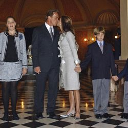 """FILE - In this file photo taken Nov. 17, 2003, Arnold Schwarzenegger kisses his wife Maria Shriver just before taking the oath of office as California's 38th governor on the steps of the Capitol in Sacramento, Calif. Also seen are the Schwarzenegger children, from left, Katherine, Christina, Patrick and Christopher.   In an interview with """"60 minutes"""" that is scheduled to air Sunday, Schwarzenegger says the affair he had with longtime housekeeper Mildred Baena, that led to a son, was """"the stupidest thing"""", he ever did to then-wife Maria Shriver."""