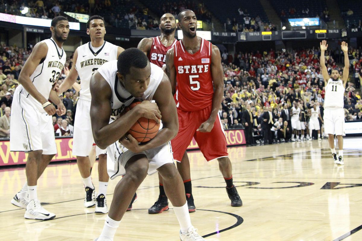 Travis McKie cradles the game ball in the waning seconds of Wake's upset victory over NC State