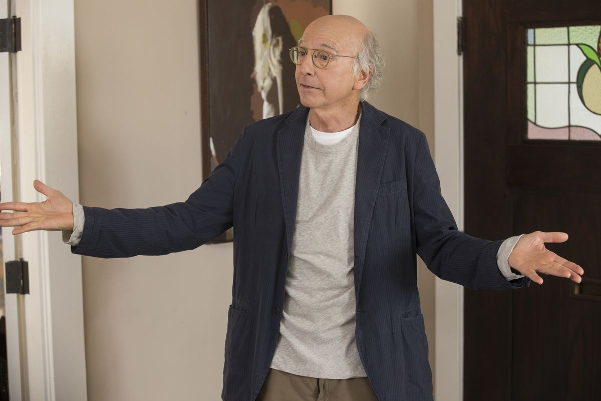Larry David throwing his arms up