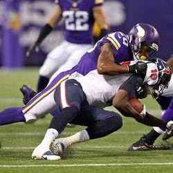 Aug 9, 2013; Minneapolis, MN, USA; Minnesota Vikings cornerback Chris Cook (20) tackles Houston Texans wide receiver Lestar Jean (18) in the first quarter at the Metrodome.