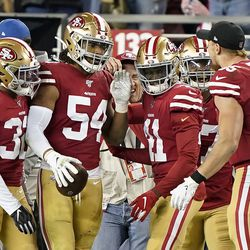 San Francisco 49ers middle linebacker Fred Warner (54) celebrates with teammates after returning an interception for a touchdown against the Los Angeles Rams during the first half of a game in Santa Clara, Calif., Saturday, Dec. 21, 2019.
