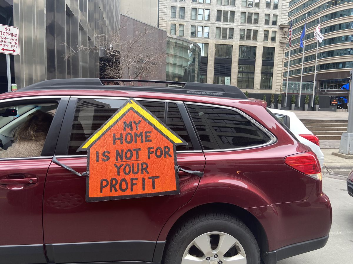 A housing justice advocate protests from their car in Minneapolis.