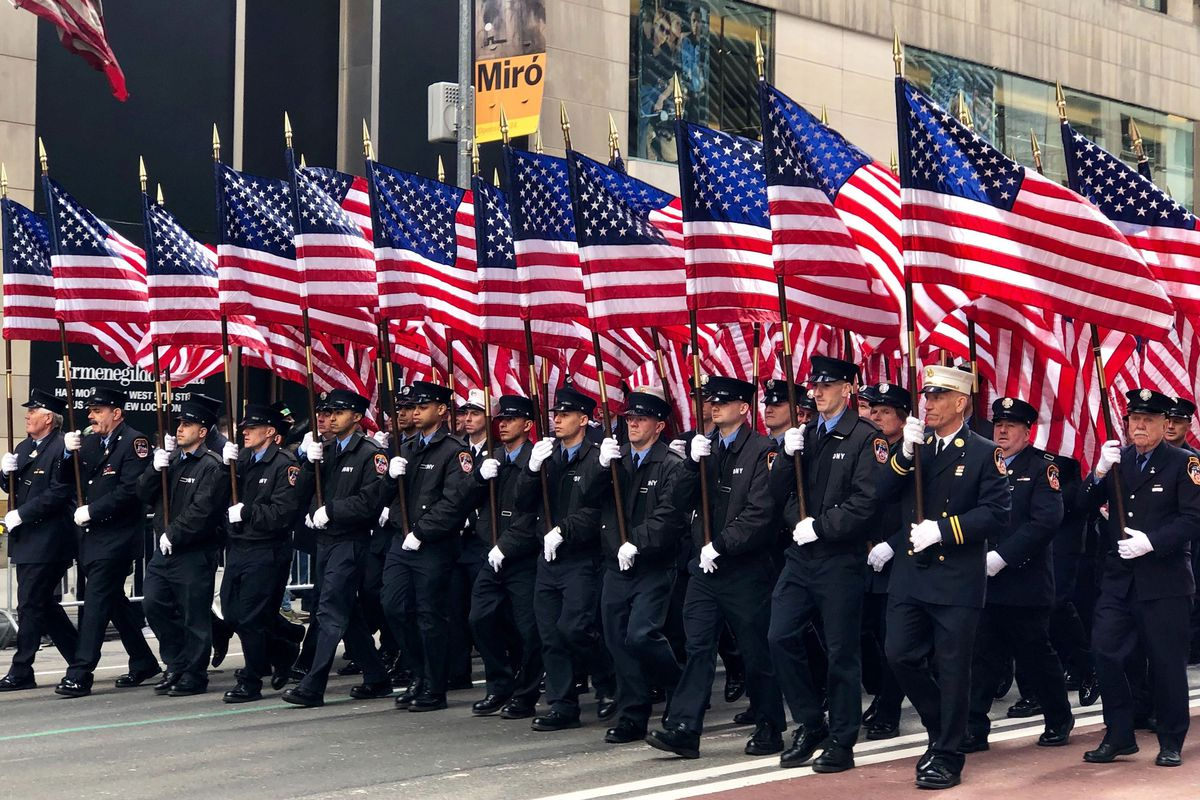 FDNY members march in the 2019 St. Patrick's Day parade.